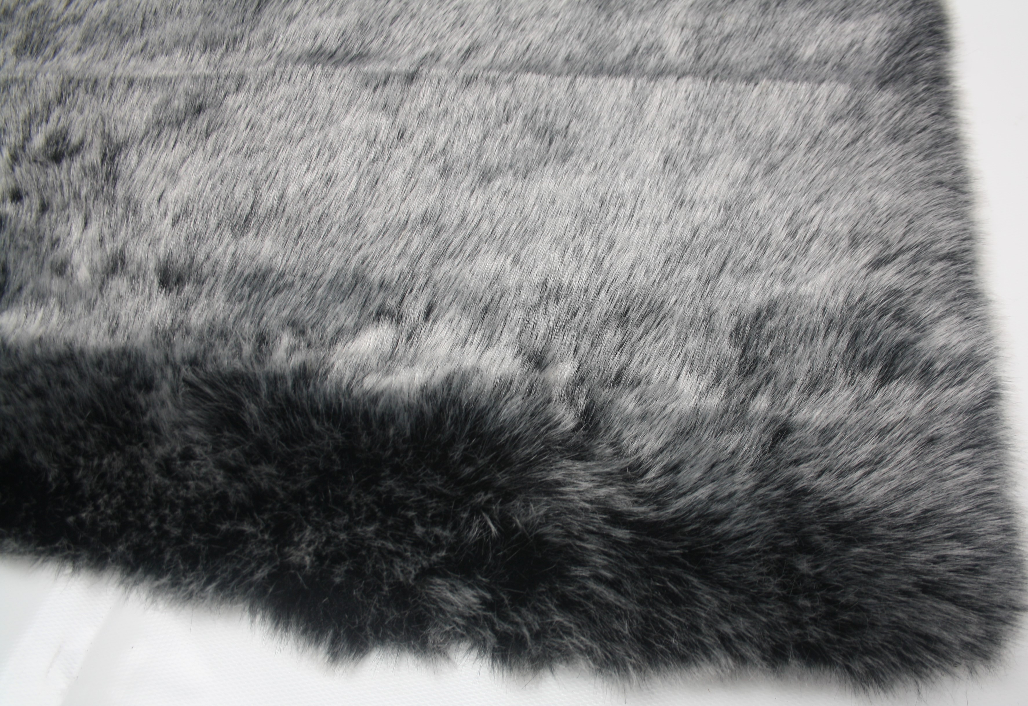 High pile carpet in the shape of a sheepskin and as a rectangle for a warm feeling during the winter.